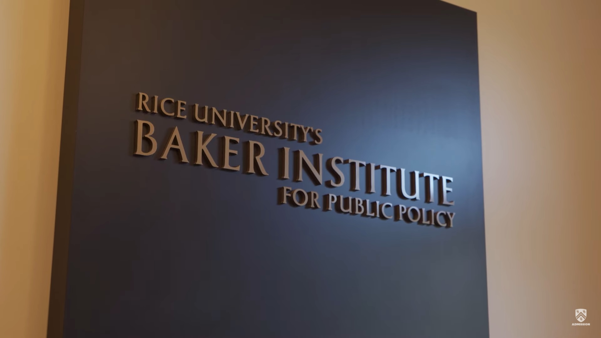 "Picture of a sign inside of Baker Hall which says ""Rice University's Baker Institute for Public Policy."""
