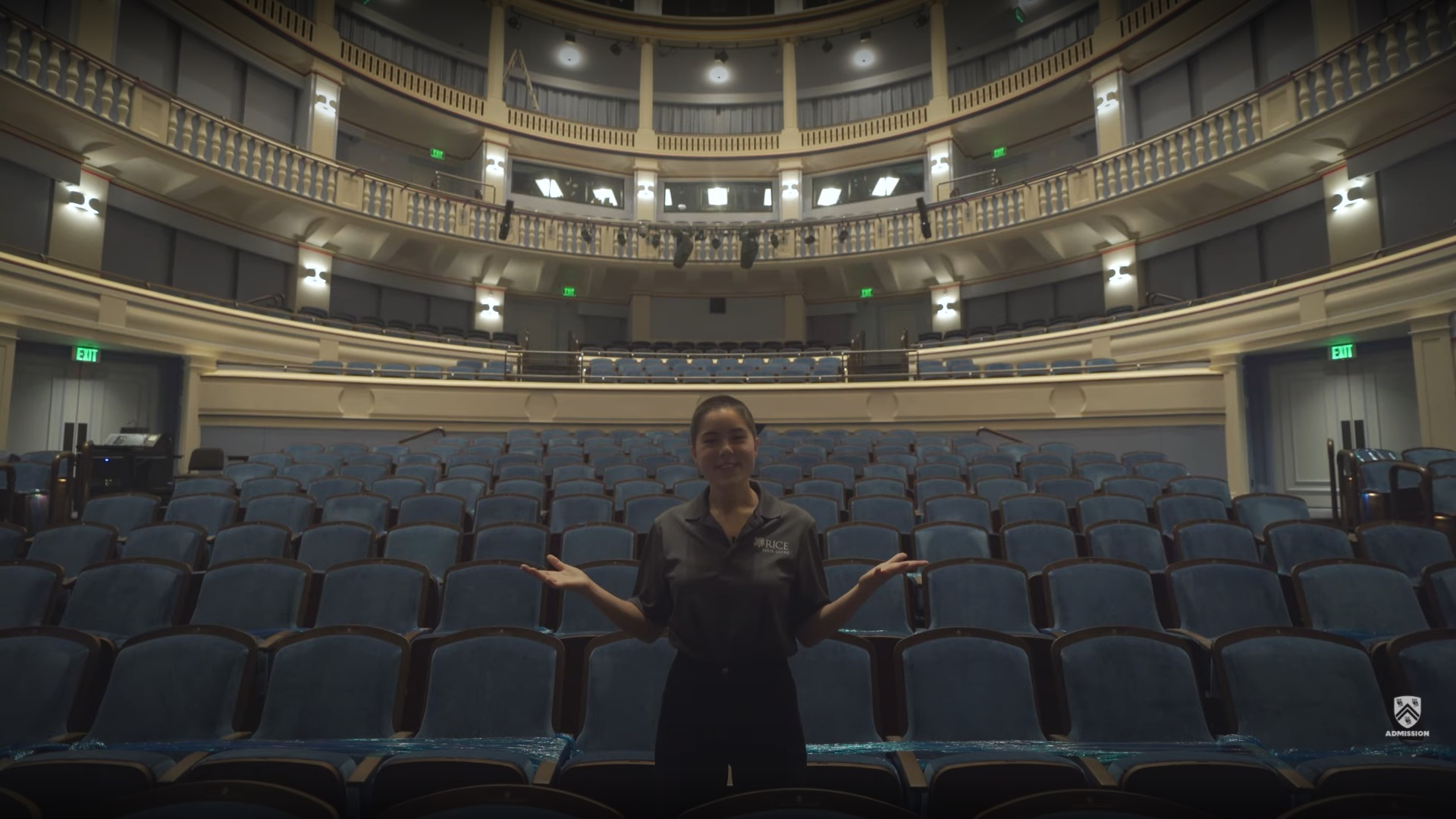 The tour guide stands in front of the main theatre inside the Brockman Hall for Opera.