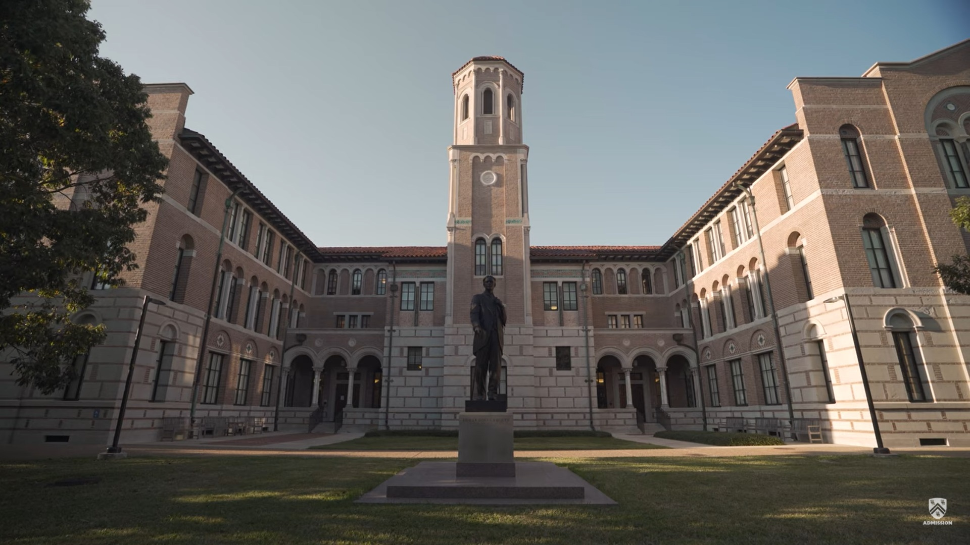 Picture of an open courtyard that part of Keck Hall, with a statue of the first president of Rice in the center.