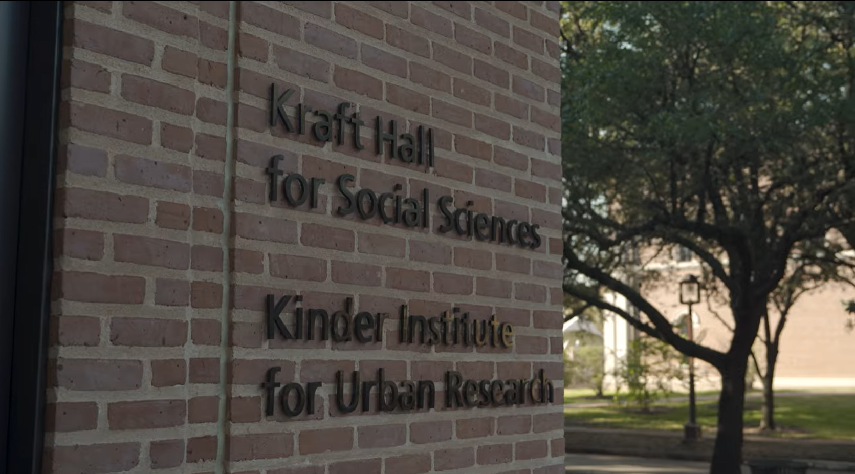 """Picture of a brick wall on the outside of Kraft Hall, with text saying """"Kraft Hall for Social Sciences,"""" and below that """"Kinder Institute for Urban Research."""""""