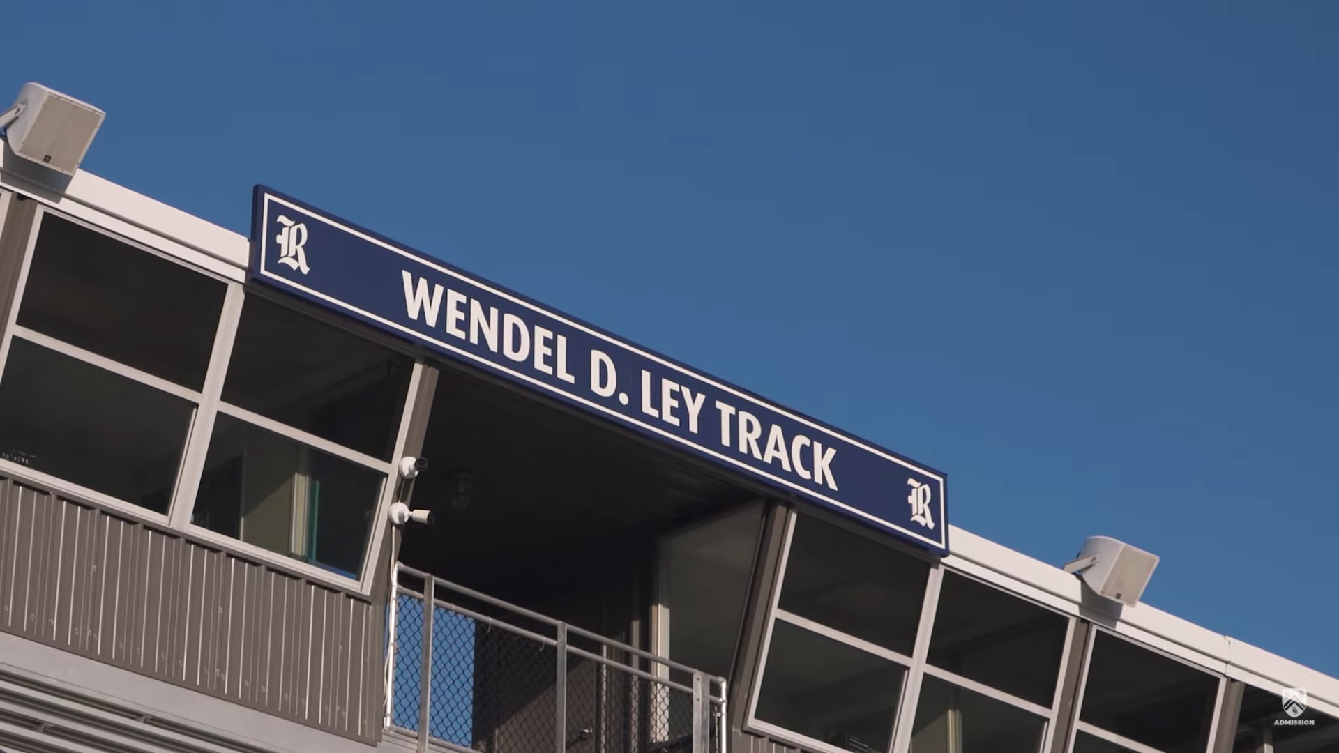 Picture of a sign inside of the stadium that says Wendel. D. Ley Track.