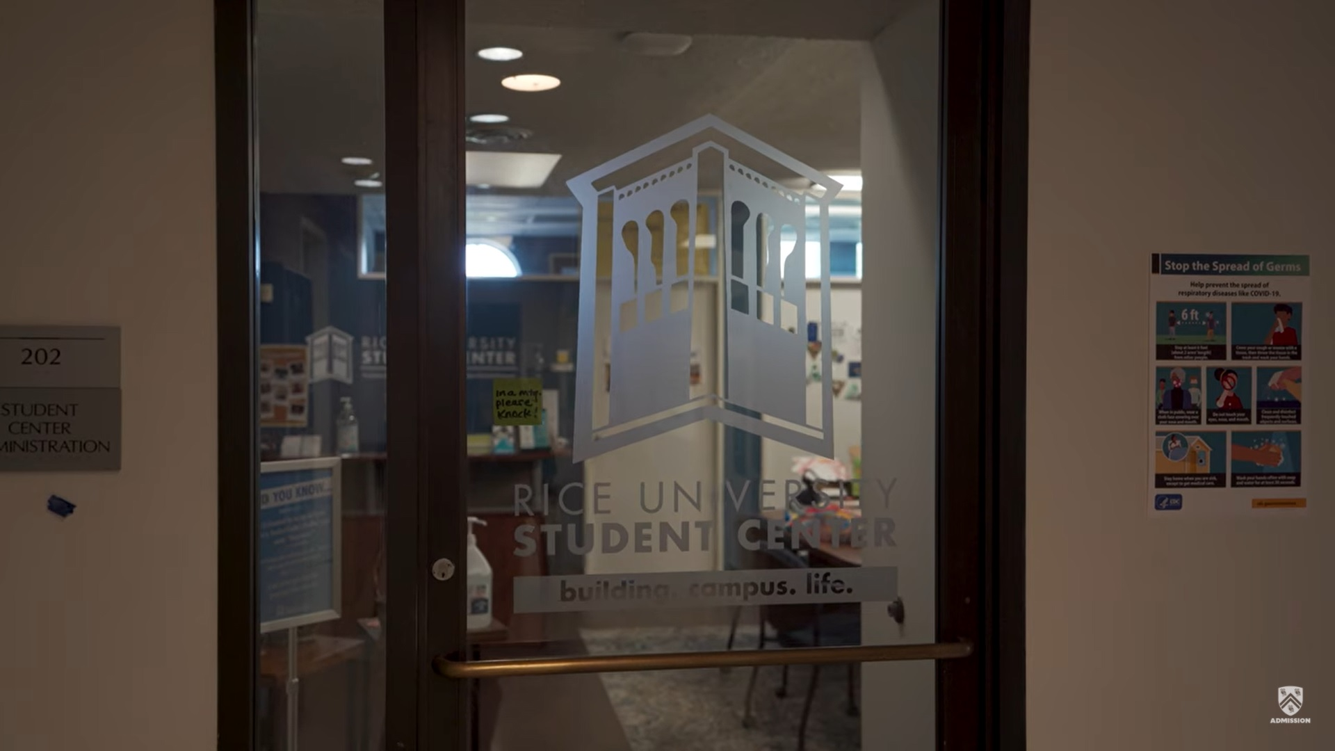 Picture of a glass door inside the RMC that is etched with a picture and says Rice University Student Center.