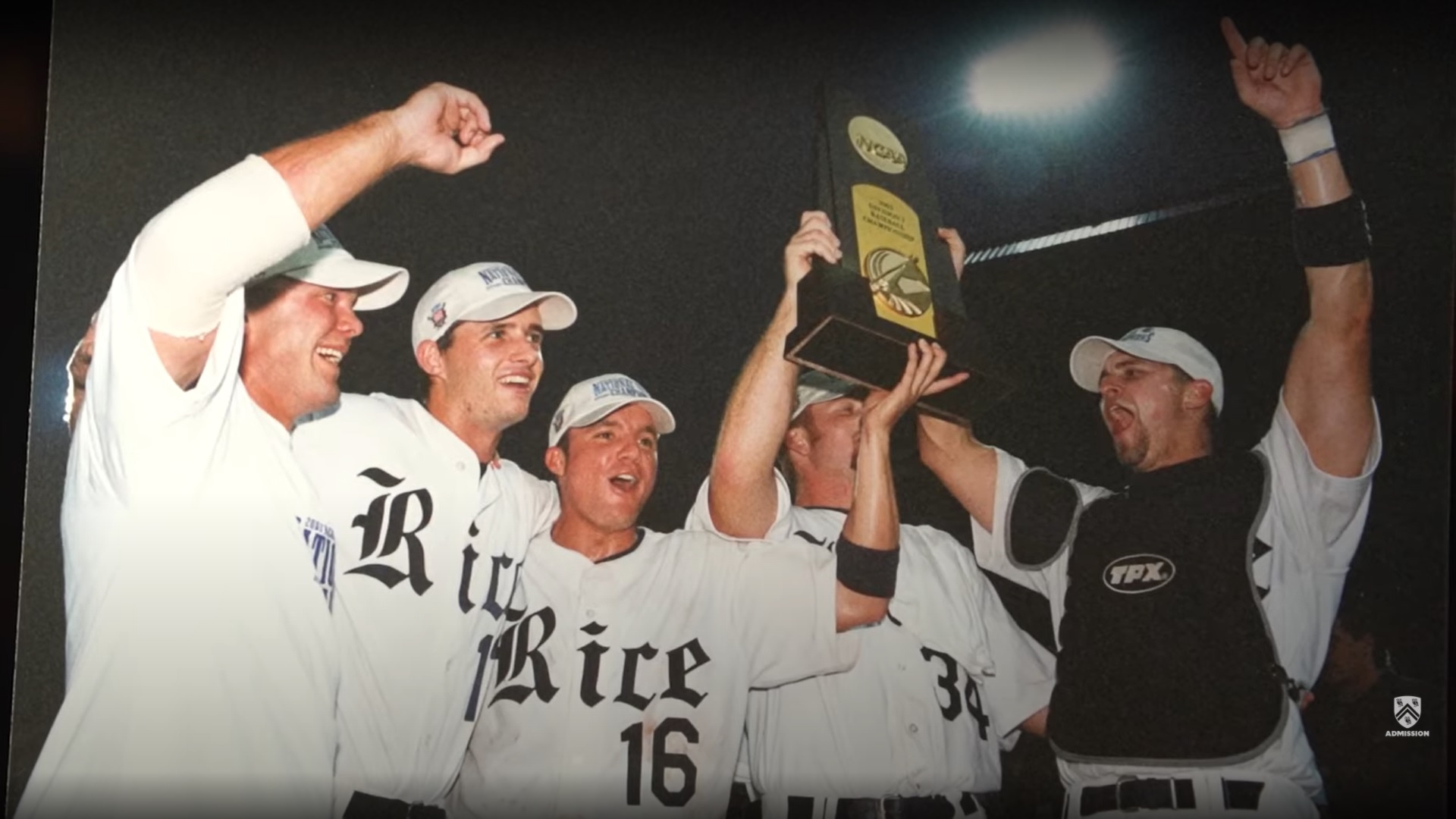 Photo depicting Rice baseball players holding up a trophy after winning.