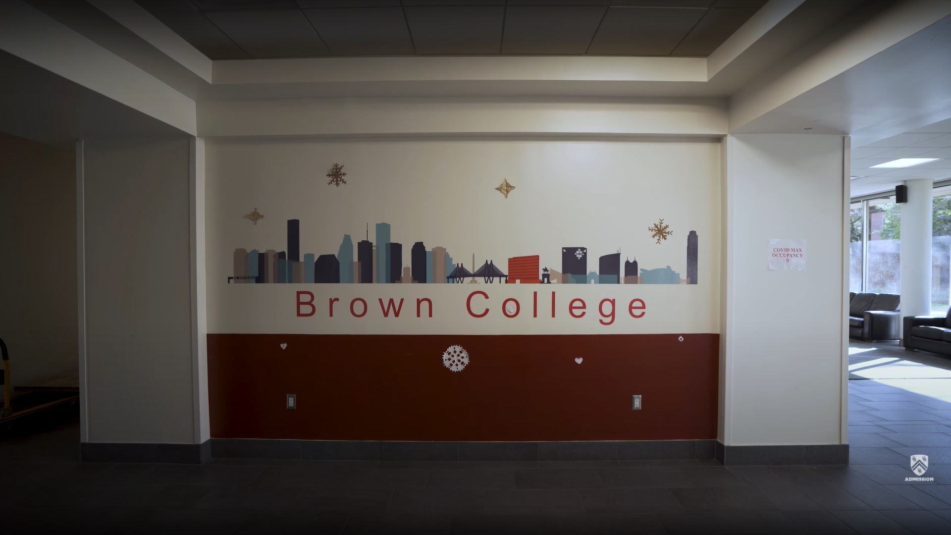 """Picture shows a wall inside of Brown College with a mural painted on it that says """"Brown College."""""""