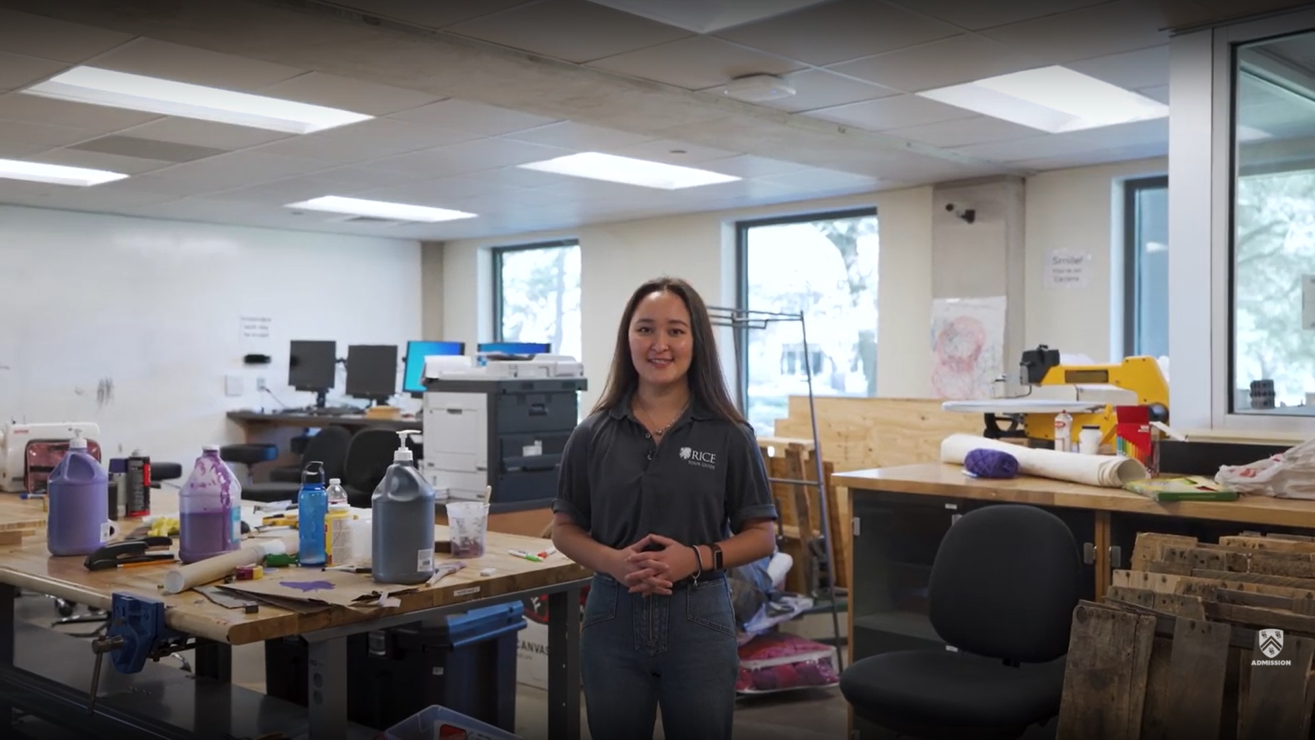 Student stands in the middle of a workroom inside McMurtry College called the McMurtry Innovation Space.