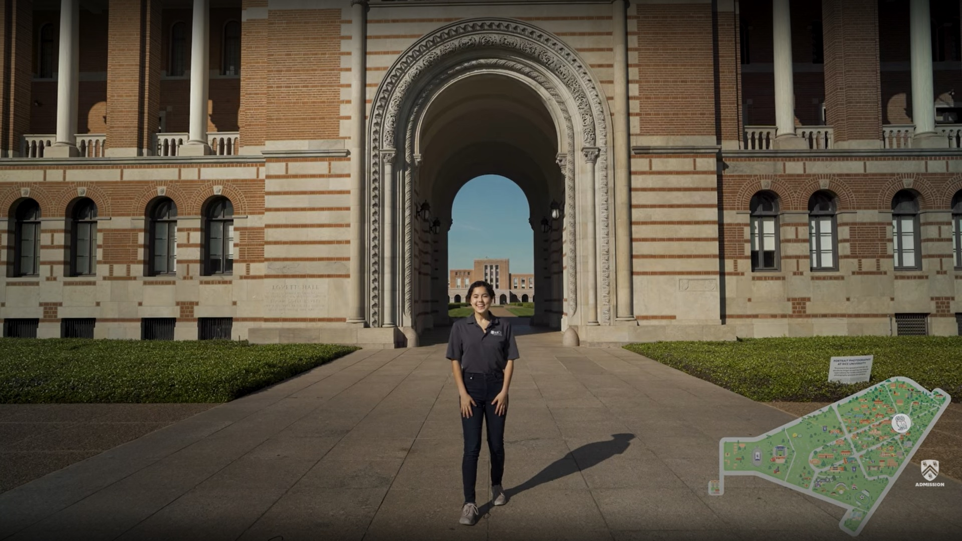 Student tour guide Lauren Ross stands in front of the iconic archway, the Sallyport, located in the center of Lovett Hall.