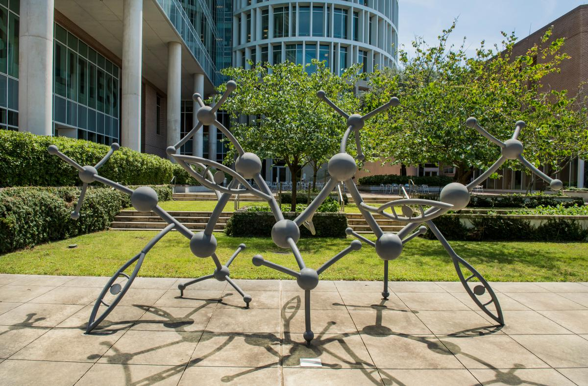 Sculpture depicting molecules connected together in a courtyard in the Bioscience Research Collaborative.