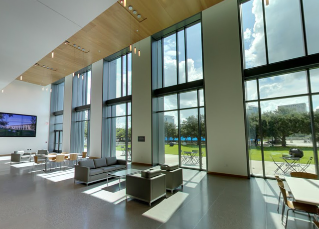 Picture taken from inside lobby of the Anderson-Clarke Center looking out onto courtyard through glass windows.