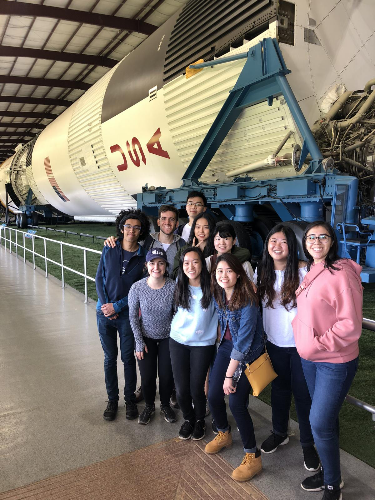 Vertical picture of students in front of a rocket at NASA.