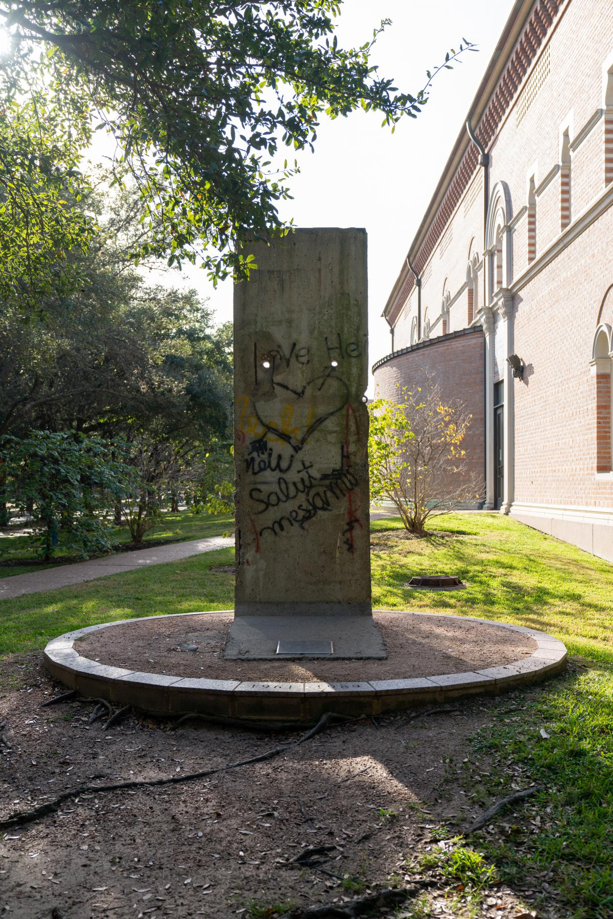 A picture of a piece of the Berlin Wall, which sits outside of Baker Hall. This piece of the Berlin Wall features graffiti, including a large heart in the center.