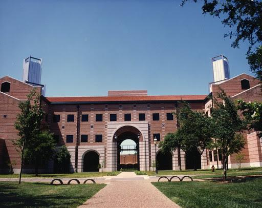 Picture of the front of George R. Brown Hall, with a large arch in the middle.