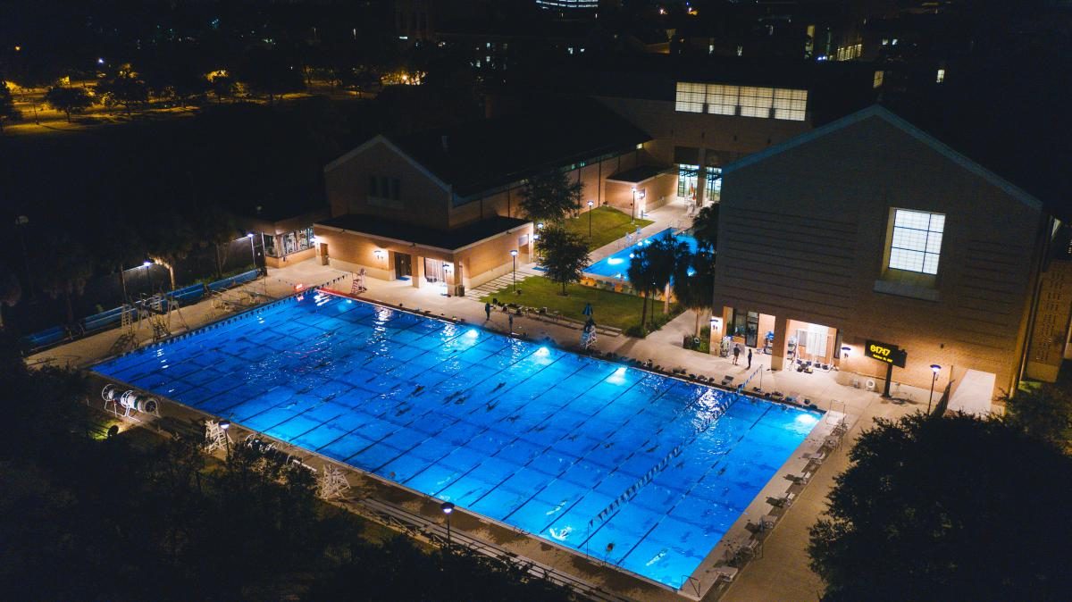 Nighttime aerial shot of competition pool at the Rice Aquatics Center.