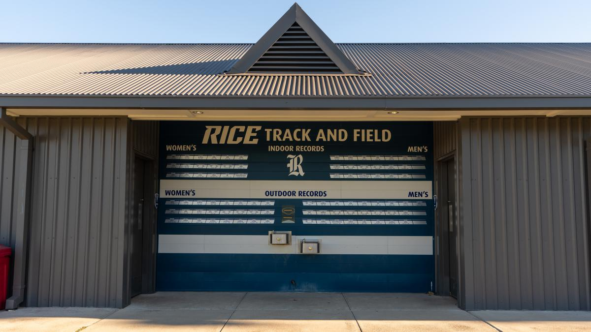Picture of the board inside the track and soccer field that shows records for Rice's Track and Field team.
