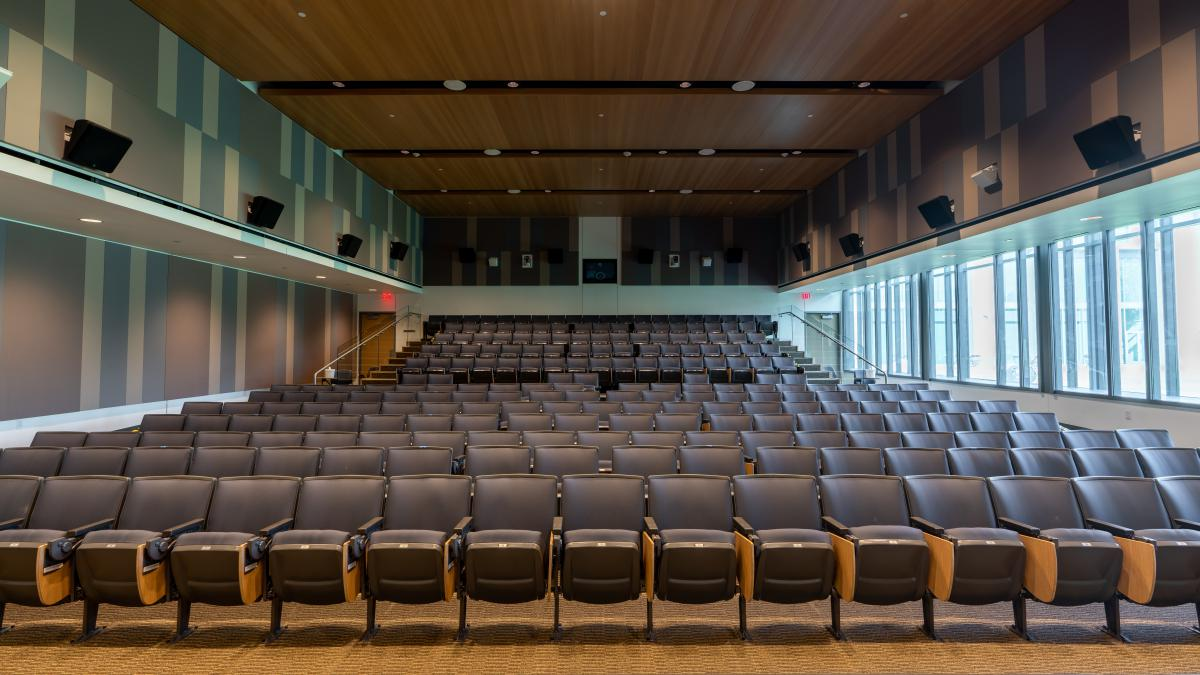 Picture taken from the front of an empty Hudspeth Auditorium showing all of the seats.