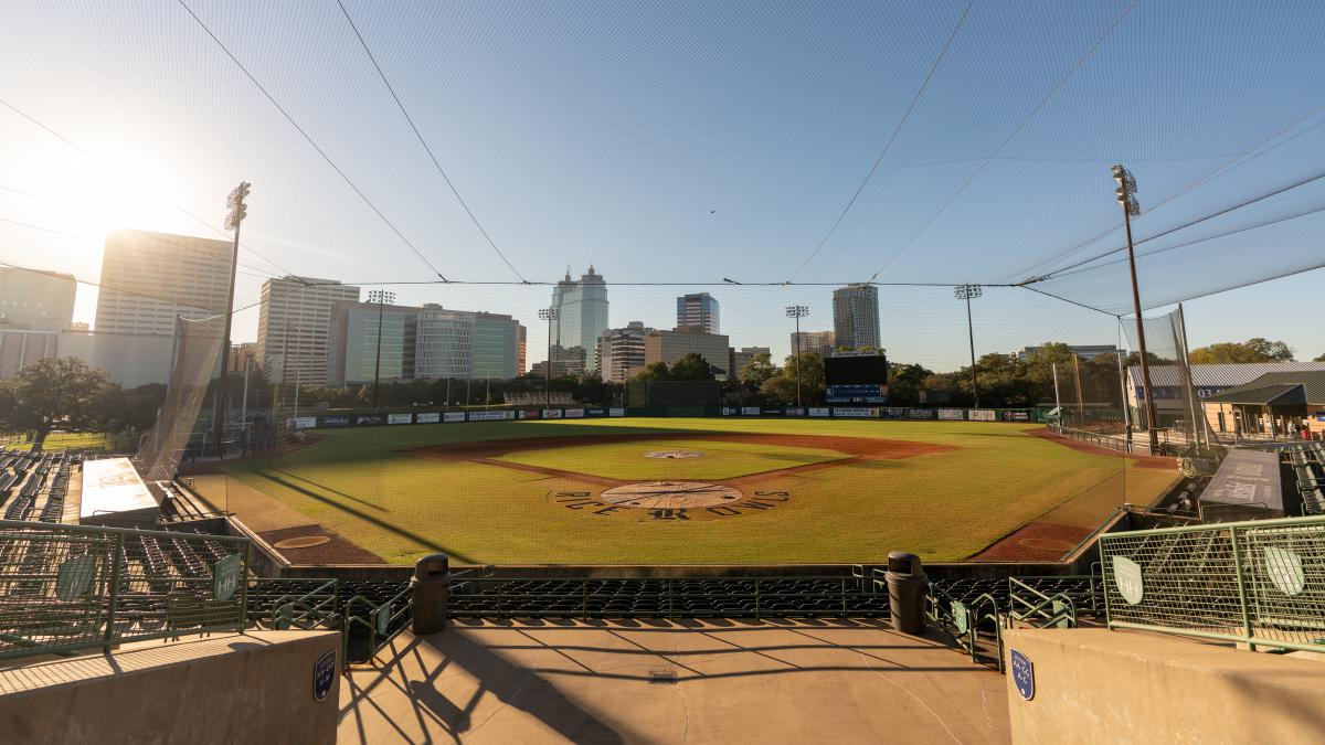 Picture of an empty Reckling Park taken from the stands, with the Texas Medical Center in the background.