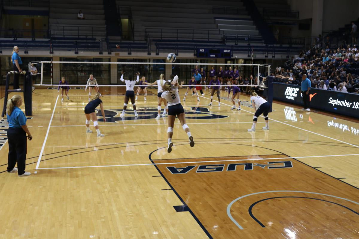 Inside picture of Tudor Fieldhouse with women's volleyball playing on the court.