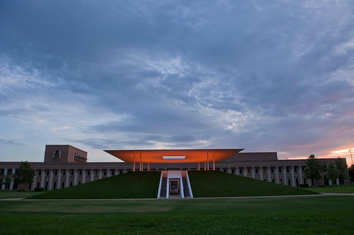Front view of the Skyspace lit up at dawn.