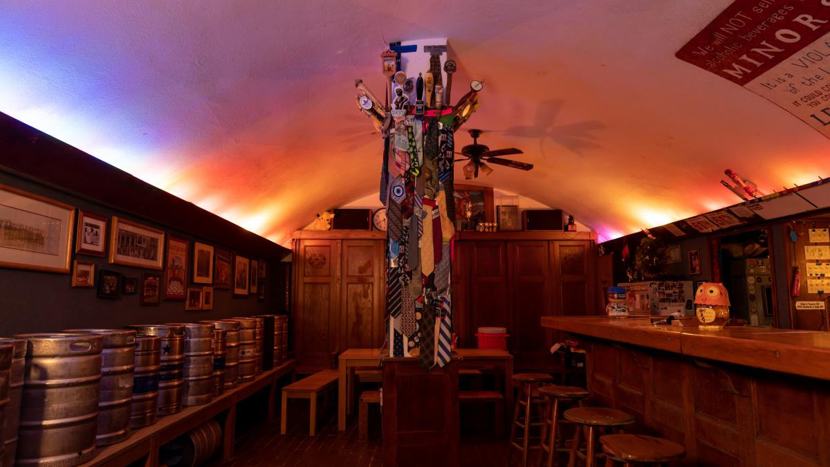Picture shows the inside of the graduate student bar, Valhalla. In the center is a pole with men's neckties tacked on.