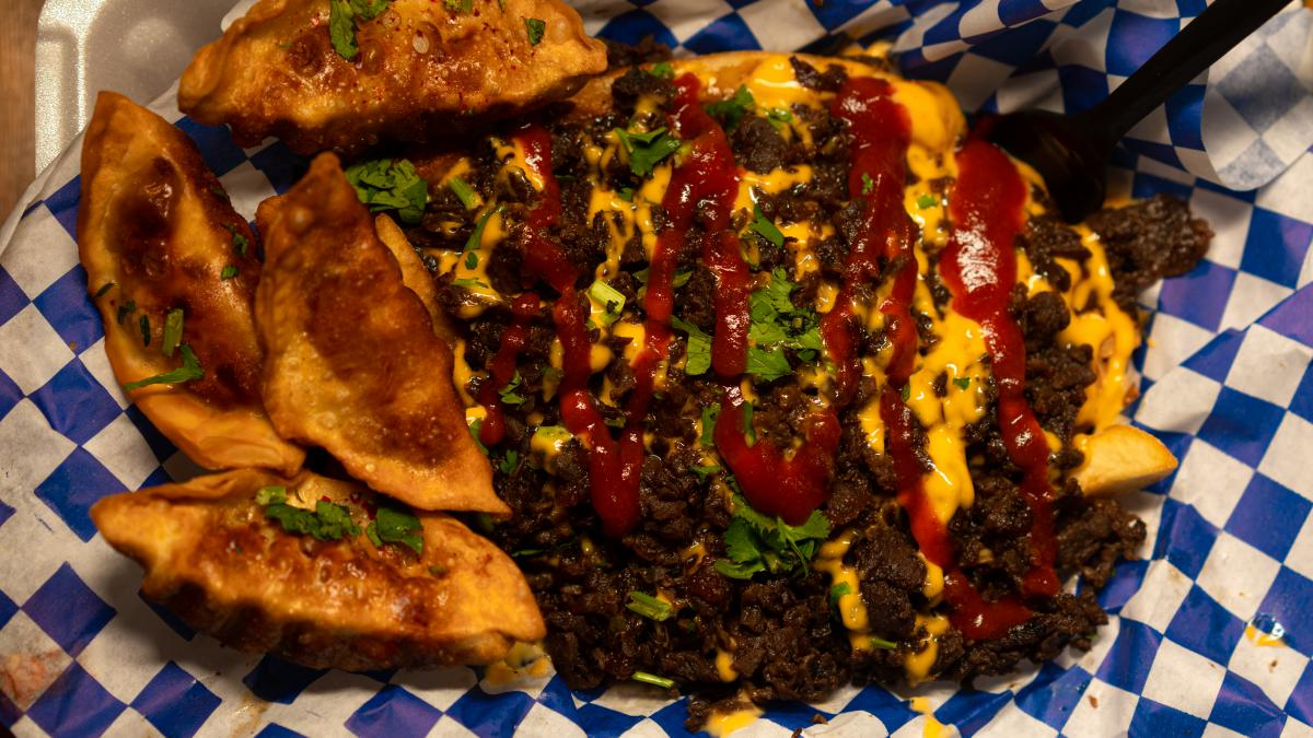Picture taken from above of fries loaded with Korean Beef from Oh My Gogi.